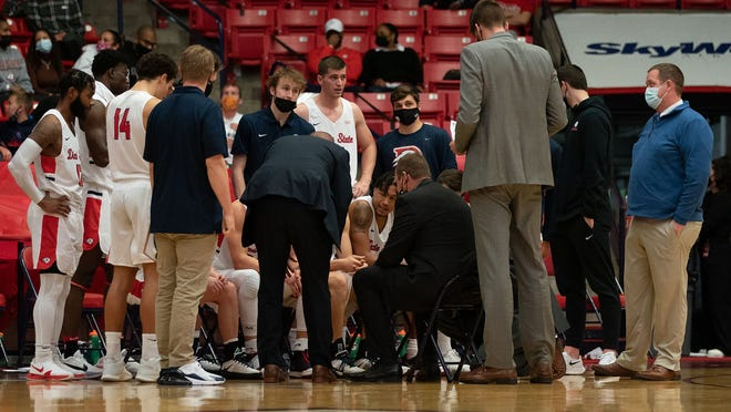 The Dixie State men's basketball team huddles during the second game of the weekend series against Seattle U. The Trailblazers split the series.