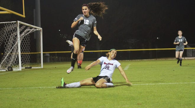 Vero Beach's Chayse McGirt closes down Dwyer's Chloe Muller as she clears the ball during the District 9-7A Championship on Monday, Feb. 8, 2021. The Panthers took a 2-1 victory.