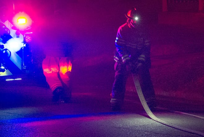 Wichita Falls Firefighters worked to cleanup after battling an early Tuesday morning vehicle fire on Lawrence Road.