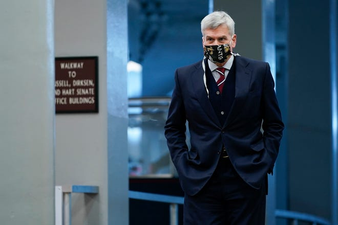 Sen. Bill Cassidy, R-La., on Capitol Hill in Washington, Tuesday, Feb. 9, 2021. The second impeachment trial of former President Donald Trump began Tuesday. (AP Photo/Susan Walsh) ORG XMIT: DCSW408