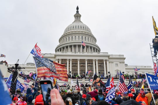 Rioters attack the U.S. Capitol on Jan. 6 as Congress meets to formally ratify Joe Biden as the winner of the 2020 presidential election.