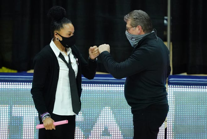 South Carolina Gamecocks head coach Dawn Staley and UConn coach Geno Auriemma meet before Monday's game.