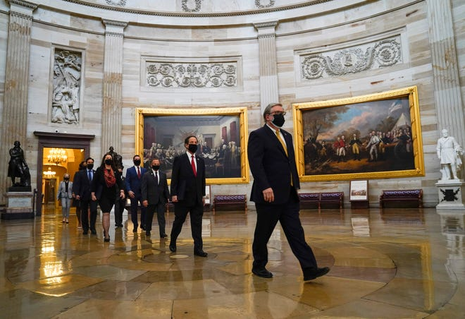 """Rep. Jamie Raskin, D-Md., second from right, and other House Managers walk through the United States Capitol rotunda on the way to the Senate Chambers to begin the second impeachment trial of former President Donald Trump.  Trump faces a single article of impeachment charging him with """"high crimes and misdemeanors"""" for inciting a mob that stormed the Capitol on Jan. 6, 2021."""