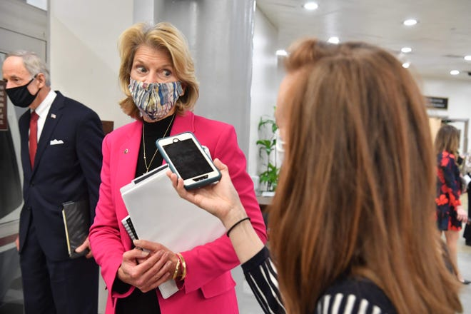 Republican US Senator Lisa Murkowski speaks to a reporter as she leaves after the first day of the impeachment trial of former US President Donald Trump on Capitol Hill, February 9, 2021, in Washington, DC. - The US Senate voted on February 9, 2021, to proceed with the impeachment trial of former president Donald Trump, rejecting defense arguments that it was unconstitutional. (Photo by Nicholas Kamm / AFP) (Photo by NICHOLAS KAMM/AFP via Getty Images) ORG XMIT: 0 ORIG FILE ID: AFP_92L8LV.jpg