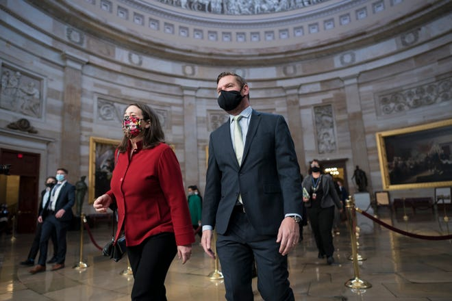 On the eve of the second impeachment trial of former President Donald Trump, Rep. Diana DeGette, D-Colo., left, and Rep. Eric Swalwell, D-Calif., and the other Democratic House impeachment managers walk through the Rotunda to the Senate to prepare for the case.