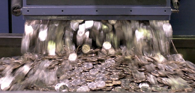 Quarters in the minting machine at the U.S. Mint on May 3, 2002, in Philadelphia.
