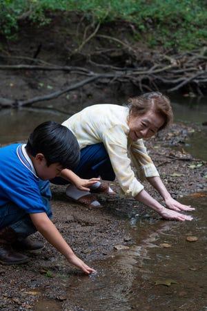 "David (Alan Kim) and his grandma (Yuh-jung Youn) form a close bond in ""Minari."""