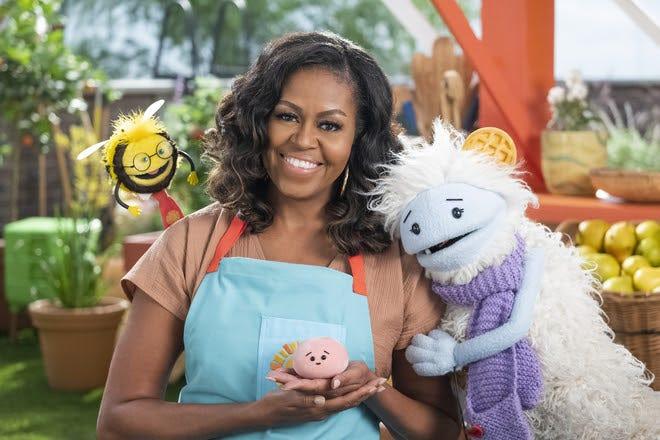 """Michelle Obama with characters from new Netflix show """"Waffles + Mochi."""""""