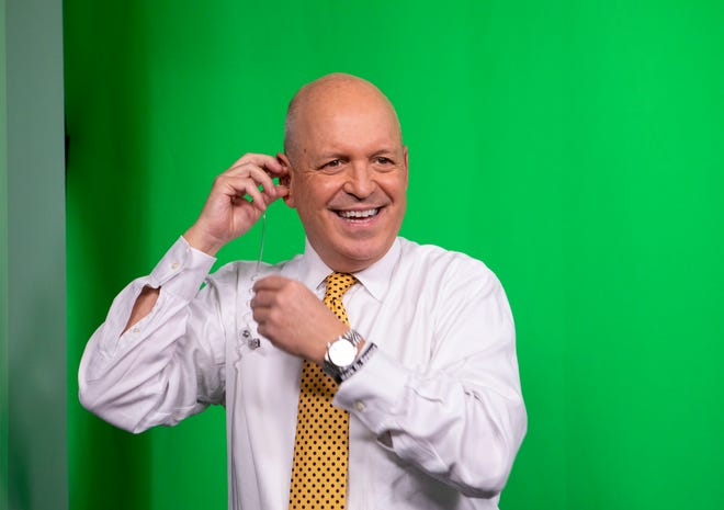Jim Spencer, a chief weathercaster for KXAN,  replaces an interruptible feedback (IFB), after his breaks on Feb. 9, 2021. Spencer is semi-retiring after 30 years with the news station but will work part-time on KXAN's First Warning Weather team. Spencer has wanted to be a weathercaster since watching his mentor, Gary England, on Oklahoma City's news in the fourth grade.