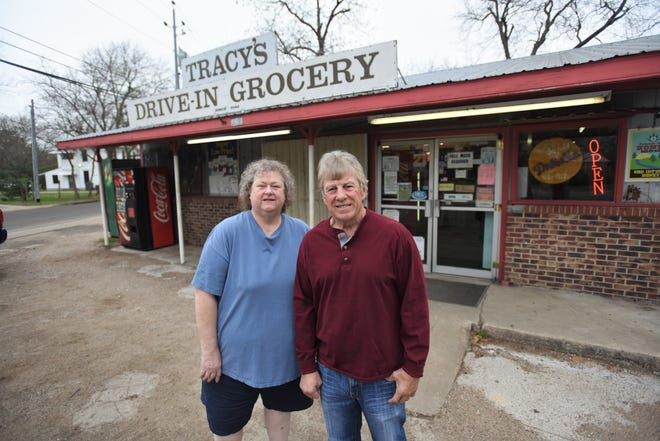 Sarah and Forrest Chalmers Jr., sister and brother, stand outside Tracy's Drive-In Grocery, which they recently sold after having been family owned since 1954.