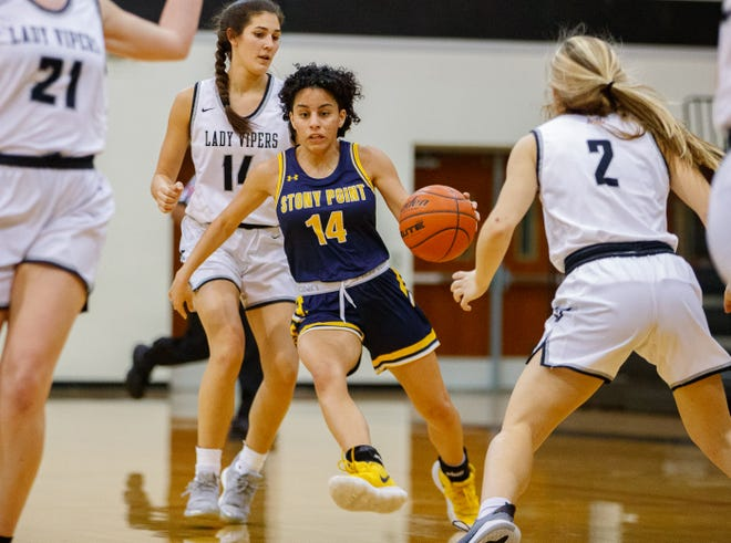 Stony Point guard Ariana Rosado, driving the ball to the basket against the Vandegrift Vipers earlier this season, helped the Tigers beat Cedar Ridge on Tuesday to clinch a spot in the postseason. Rosado has scored more than 1,500 points in her prep career, becoming the second-leading all-time scorer in school history.