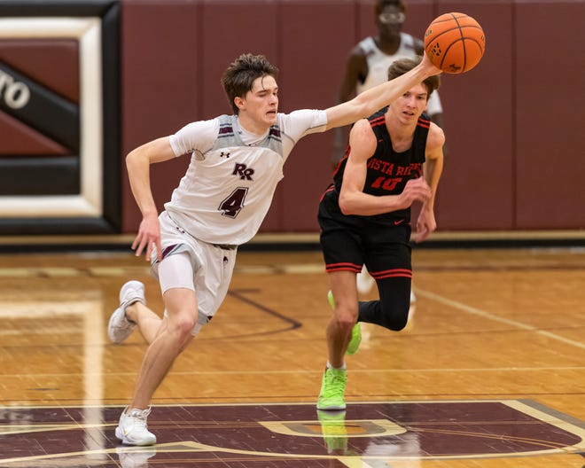 Braden Lee, left, makes a steal for Round Rock in front of Braedyn Dawes of Vista Ridge. Round Rock won a district boys basketball game at home over Vista Ridge, 88-57, on Feb. 9.