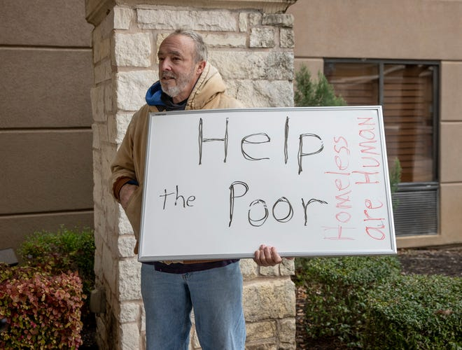 At a news conference on February 10, where Williamson County officials spoke against Austin's plan to buy the Candlewood Suites to house homeless people,  Jim Dillon of Liberty Hill shows his opposing view.