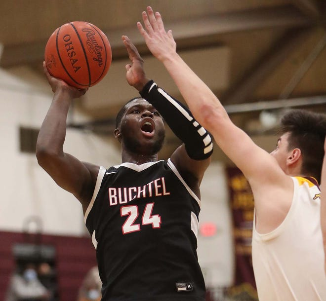 Chris Livingston of Buchtel takes a shot over Eric Stern of Walsh Jesuit during the second half of their game at Walsh Jesuit High School, Feb. 9, 2021. [Karen Schiely/Beacon Journal]