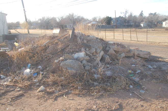 A mound of asphalt rests among the debris discarded in the rear of the 2700 block of SW 10th Ave. The Amarillo City Council has adopted the first reading of an ordinance creating a civil penalty for certain unlawful dumping and providing for civil cost recovery for illegal dumping.