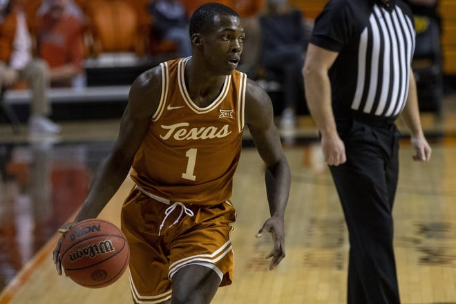 Texas guard Andrew Jones, seen here playing against Oklahoma State last Saturday, scored a team-high 24 points in Tuesday night's 80-77 win over Kansas State in Manhattan, Kan.