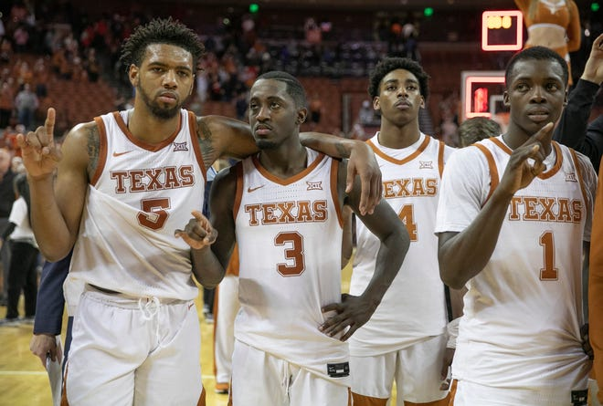 Texas basketball players, from left to right, Royce Hamm Jr., Courtney Ramey, Donovan Williams and Andrew Jones stand together after a 2020 home loss to Texas Tech.