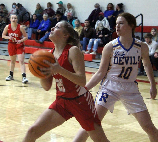 Davis' Logan Pruitt drives past a defender earlier this season. The junior finished with 24 points Tuesday to lead the Lady Wolves to a 53-24 win over Lexington.