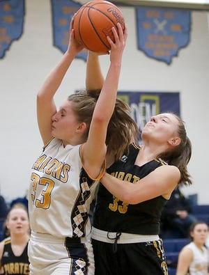 Hillsdale's Kayla Vistucis (33) grabs a rebound over Black River's Lilly Stief (33) during the Falcons' 61-32 win. Vistucis finished the game with a school single-game record 28 rebounds.