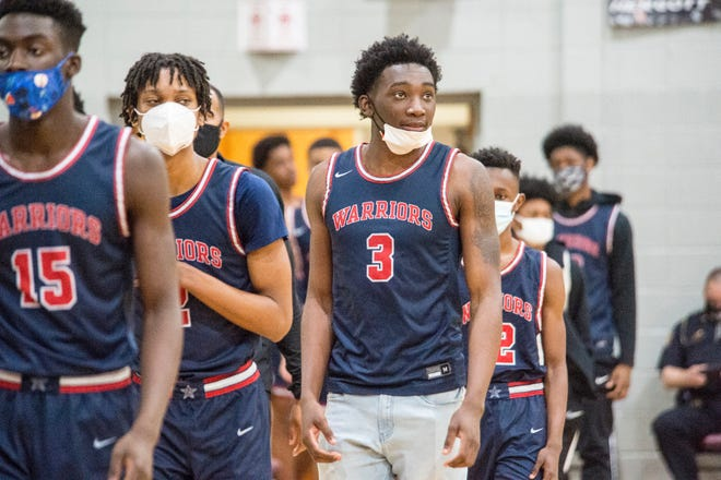 Grovetown basketball player Jadis Gant, middle, walks out the floor with his teammates before the start of the second half during a game at Lakeside High School in Evans, Ga., Tuesday evening February 9, 2021.