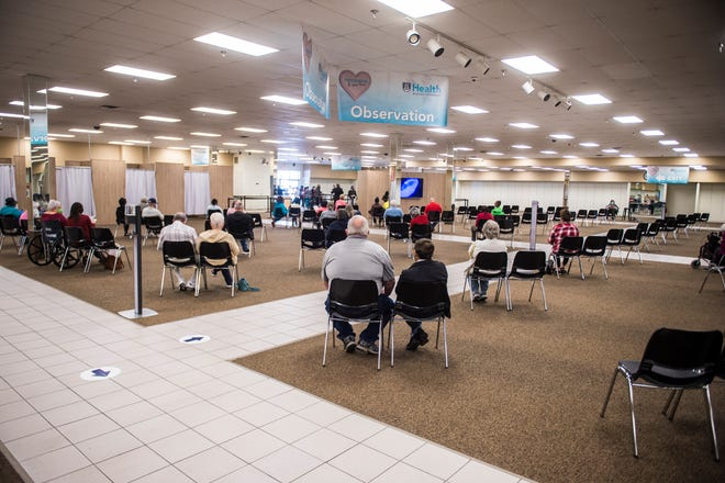 After getting their shots, people wait in the observation area at the new COVID-19 vaccination clinic at the former Stein Mart store in Augusta, Ga., Wednesday morning February 10, 2021.