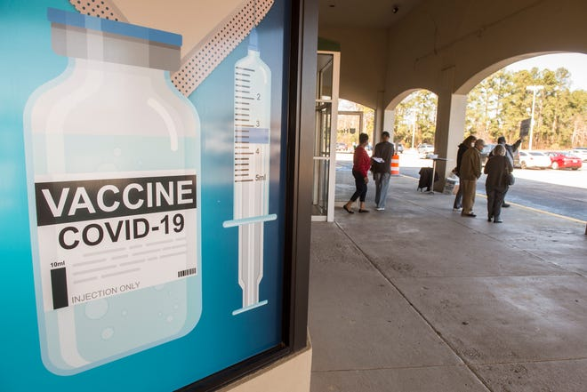 People come and go at the new COVID-19 vaccination clinic at the former Stein Mart store in Augusta, Ga., Wednesday morning February 10, 2021.