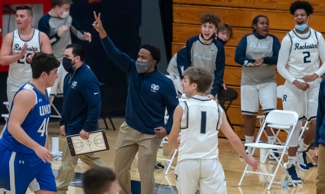 Rochester players and coaches celebrate their first half lead over Union Tuesday at Rochester High School.
