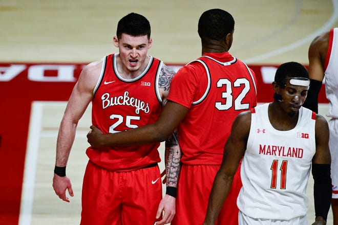 Feb 8, 2021; College Park, Maryland, USA;  Ohio State Buckeyes forward Kyle Young (25) reacts after being fouled with forward E.J. Liddell (32) as Maryland Terrapins guard Darryl Morsell (11) walks away during the second half at Xfinity Center. Mandatory Credit: Tommy Gilligan-USA TODAY Sports