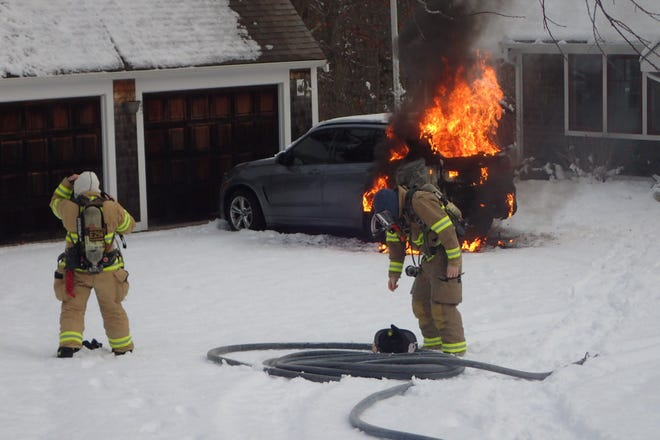 Firefighters extinguish a car fire Tuesday morning on High Street in West Barnstable. [Courtesy of West Barnstable Fire Department]