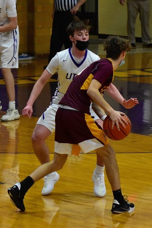 Kaden Otto applies the defensive pressure in the third quarter in Canton's 57-37 loss to East Peoria. Otto would lead his Little Giant team in scoring with 12 points.