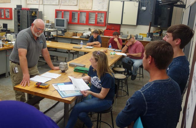 Spoon River College faculty Todd Thompson talked with visitors about the Diesel and Power Systems Technology program he teaches at the College during a past open house. That is one of the Career and Workforce Education programs that will be featured at the College Visit Day March 2.