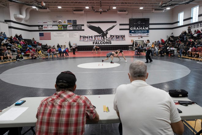 Wrestlers participate in the Central Buckeye Conference tournament in February at St. Paris Graham High School, where Jim Jordan won four state individual wrestling titles as a high schooler. The congressman says the sport provided a foundation for his approach to life.