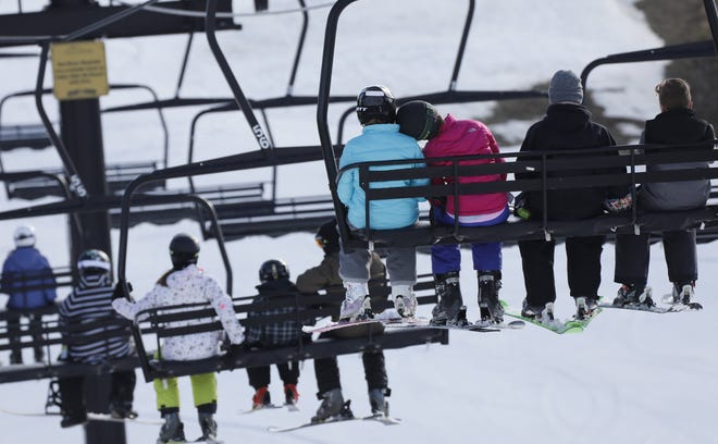 Skiers and snowboarders take the chair lift up the hill at Mad River Mountain ski resort in Valley Hi, Ohio, on Thursday, Jan. 2, 2020.