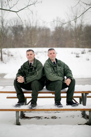 Dan Kaderly, left, and his identical twin brother, Matt, are both park rangers for Franklin County Metro Parks.