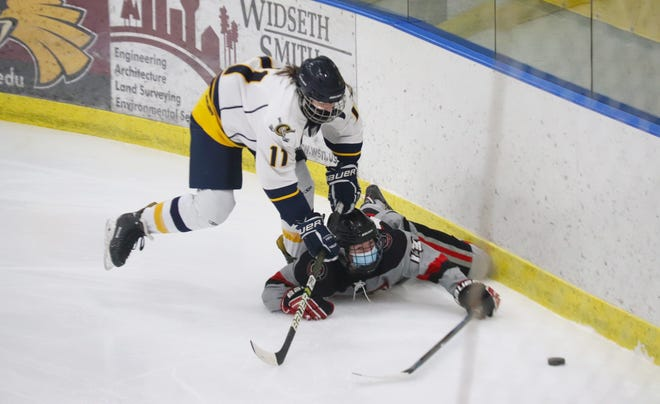 Grace Fischer takes down a Grand Forks player in the defensive zone. Crookston fell to the KnightRiders, 5-2, Tuesday night to see its three-game winning streak come to an end.
