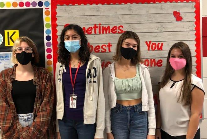 From left, Alyssa Wisniewski, Nia Rodriguez, Haley Abbott and Ashley Ellixson are part of the Tavares High Teaching Academy.