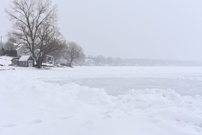 What looks more like a frozen tundra scene is actually an ice- and snow-covered Devils Lake. The lake, seen Wednesday afternoon, is in perfect condition for this weekend's Tip-Up Festival, hosted by the Devils and Round Lake Men's Club.