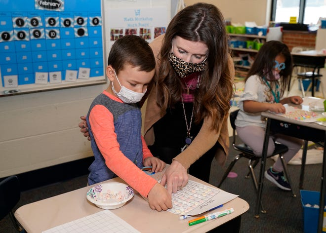 Kindergarten teacher Christie Richards helps Kaleb Rink count his Smarties Wednesday at Alexander Elementary School. Wednesday was the 100th day of school this academic year for Adrian Public Schools students.