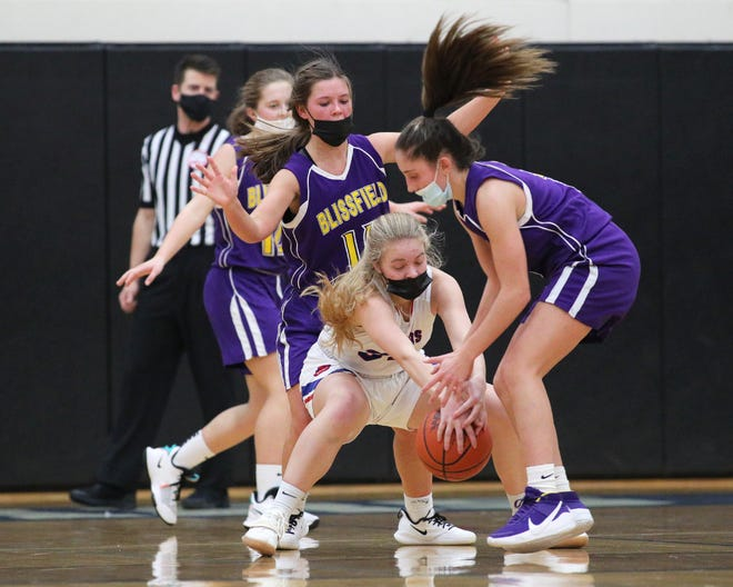 Blissfield's Sierra Spallone and Lenawee Christian's Cara Anderson battle for the ball during a game Monday. Blissfield returned to action Tuesday and beat Hillsdale, 67-19.