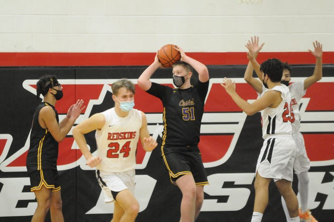 Onsted's Ayden Davis pulls down a rebound during Tuesday's game at Clinton. Deloris Clark-Osborne
