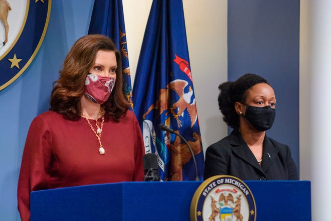 Gov. Gretchen Whitmer, left, speaks as Michigan Department of Health and Human Services Chief Medical Executive, Dr. Joneigh Khaldun, listens in Lansing, Tuesday, Feb. 9. [Michigan Office of the Governor via AP]