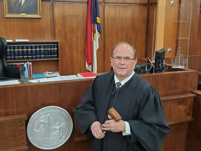 Chief District Judge Wayne Michael, who retired from the bench on Feb. 1, stands in Courtroom 1, formerly Courtroom A, at the Davidson County Courthouse. In this courtroom, Michael was sworn in as an attorney, tried his first and last jury trial served his first and last day as a District Court judge.