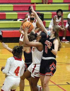 Salisbury's Kyla Bryant goes for a shot against the defense of North Davidson's Lettie Michael (11). [Wayne Hinshaw for the Salisbury Post]
