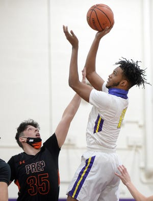 Erie High's Marquell Darnell shoots over Cathedral Prep's Liam Galla on Tuesday in the District 10, Region 6 game at Erie High School.