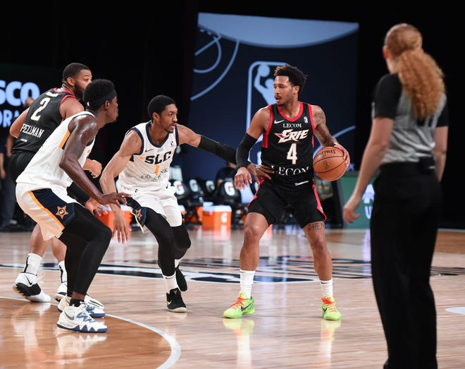 Erie BayHawks guard Jalen Adams, right, runs the offense against Salt Lake City on Wednesday, Feb. 10, 2021, in the BayHawks' NBA G League season opener in Orlando, Florida. Adams had 14 points, nine rebounds and seven assists in Erie's 117-98 victory.