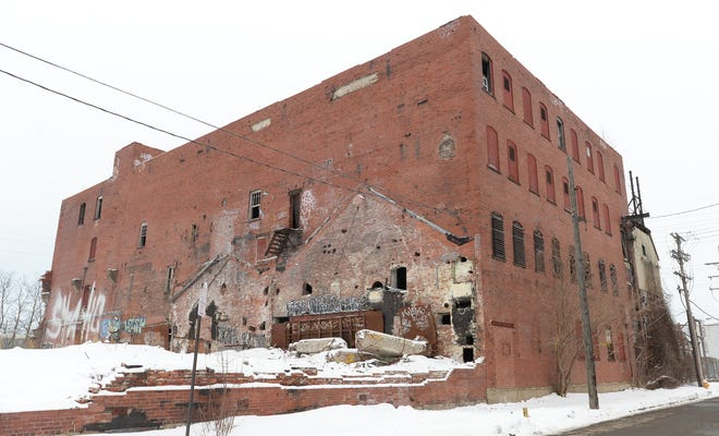 """The former Quin-T Tech Paper and Boards building is coming down, for """"A Change of ScenErie."""""""
