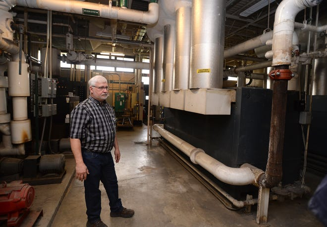Del VonVolkenburg, facilities manager at Erie County Technical School in Summit Township, shows the aging boilers at the school in May 2019.