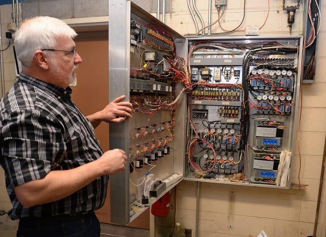Del VonVolkenburg, facilities manager at Erie County Technical School in Summit Township, shows the antiquated heating and cooling control panel at the school in May 2019.