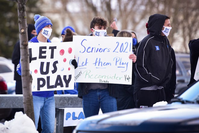 Dolgeville athletes conduct a rally outside of the Herkimer County office and courts facility Wednesday, Feb. 10, 2021. The rally was formed to convey a message that high school winter sports should be in effect for Herkimer County. Those who participated say they are upset that a plan was developed with no input from coaches, athletes or parents.