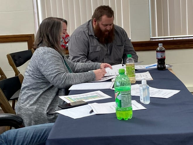 American Federation of State, County and Municipal Employees Union Representative Amber Moats, left, and ASFME Local 828 president Aaron Siefken, right, meet Tuesday with city officials as part of contract negotiations. This marks the first city negotiation since certain language was allowed to be removed from contracts.